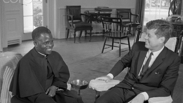 08 Jun 1961, Washington, DC, USA --- Original caption: Presidents meet.  Washington, D.C.: Suffering from a strained back, President John F. Kennedy sits in his rocking chair as he confers with President Fulbert Youlou (left) of the Republic of the Congo, in his office here, June 8th. President Youlou heads the Republic of Congo which recently achieved independence and was not the scene of recent U.N. intervention. Dr. Janet Travell, President Kennedy's personal physician, prescribed the chair for the President so that he may relax. --- Image by © Bettmann/CORBIS